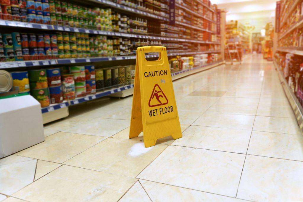 Caution Wet Floor Sign in Grocery Store