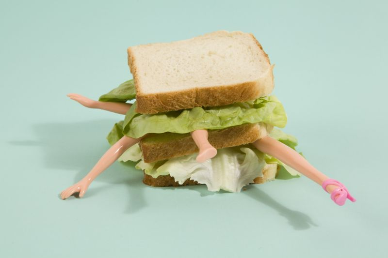 sandwich with doll legs sticking out of it