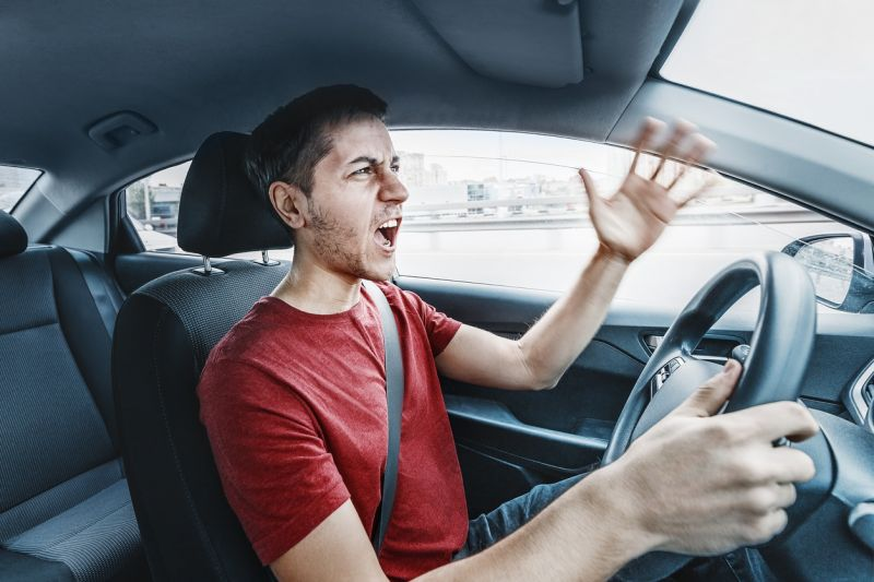 man yelling at bad drivers